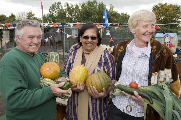 Pushpa Lad, centre, with allotment volunteer, Elaine Gray