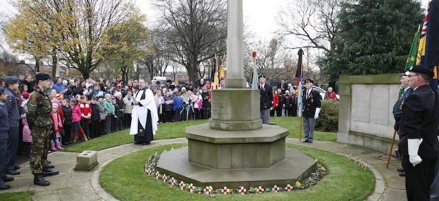 Rev David Grey leads the service at the war memorial