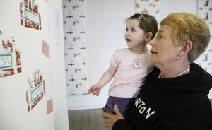 """Have you done all this Grandma?"" Two year-old Sophie Ledward, admires the handiwork of GVA member, Rita Oakley."