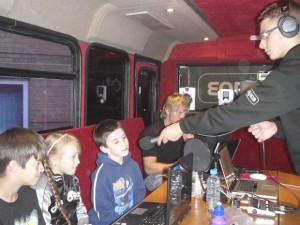 Recording for our jingle on the Key 103 bus